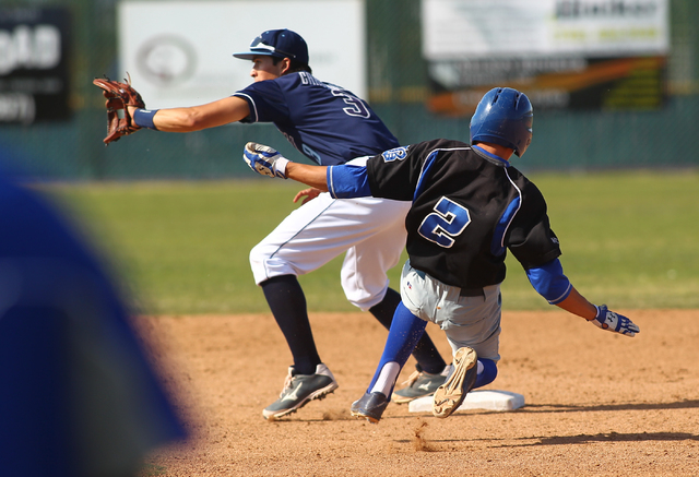 Basic's Cory Wills (2) slides into second base as Foothill's Nick Cardinale waits for the throw during the second inning Thursday at Foothill. Wills was out on the play. (Chase Stevens/Las Vegas R ...