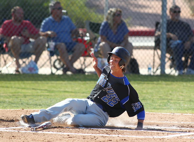 Skyler Mahoney of Basic slides into home during the first inning Thursday at Foothill. Mahoney scored two runs and went 1-for-3 with a triple and a stolen base in the Wolves' 5-0 victory. (Chase S ...