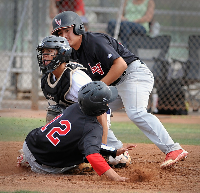 Shadow Ridge catcher Robbie Galvan attempts to tag out Las Vegas' Kyle Christensen (12) at the plate with Las Vegas' Jose Sanchez at bat on Tuesay. Christensen was called safe due to Galvan steppi ...