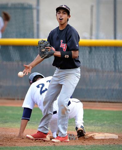 Las Vegas first baseman Eddie Ojeda smiles the WilShadow Ridge's Antonio Arreola during a high school baseball game at Las Vegas High School on Tuesday, April 15, 2014. (David Becker/Las Vegas Rev ...