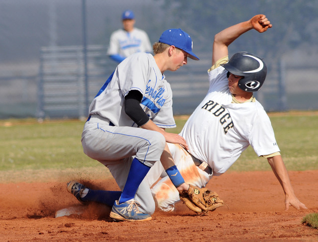 Shadow Ridge's Jacob Chambers slides safely into second while Sierra Vista's Chandler Smith waits for the ball in the third inning on Thursday. Shadow Ridge won the game, 6-1. (Jerry Henkel/Las Ve ...