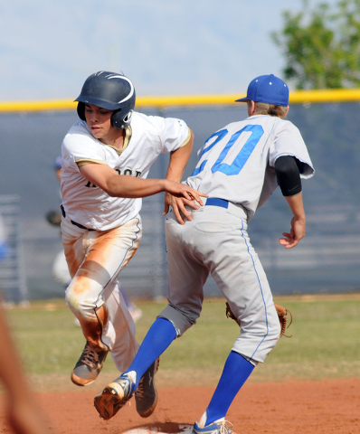 Shadow Ridge's Jacob Chambers slips by Sierra Vista's Chandler Smith at second after a wild throw in the third inning on Thursday. Shadow Ridge won the game, 6-1. (Jerry Henkel/Las Vegas Review-Jo ...