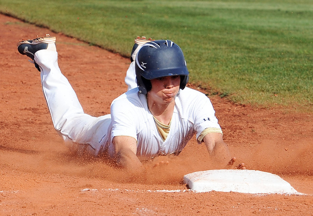 Shadow Ridge's Jacob Chambers slides safely into third in the third inning on Thursay. Shadow Ridge won the game, 6-1. (Jerry Henkel/Las Vegas Review-Journal)