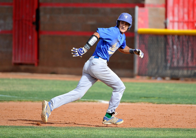 Green Valley's Keola Paragas runs back to first base, avoiding a pick off, during a recent game against Las Vegas High. (David Becker/Las Vegas Review-Journal)