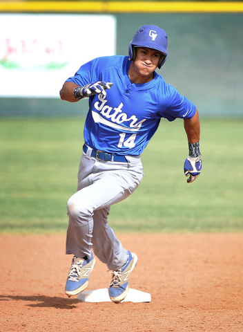 Green Valley's Keola Paragas rounds second base on his way to a stand-up triple during a recent game against Las Vegas High. (David Becker/Las Vegas Review-Journal)