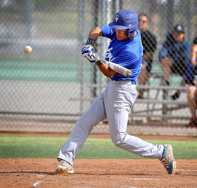 Green Valley's Keola Paragas swings for the ball during a recent game against Las Vegas High. Paragas has hit .348 with two homers and 21 RBIs this spring. He's also bounced back from an arm injur ...