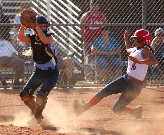 Foothill catcher Hannah Stevens (15) looks to throw to complete a double play after forcing out Liberty's Ashleigh Rodriguez at Liberty High School in Henderson on Tuesday, April 23, 2014. Foothil ...