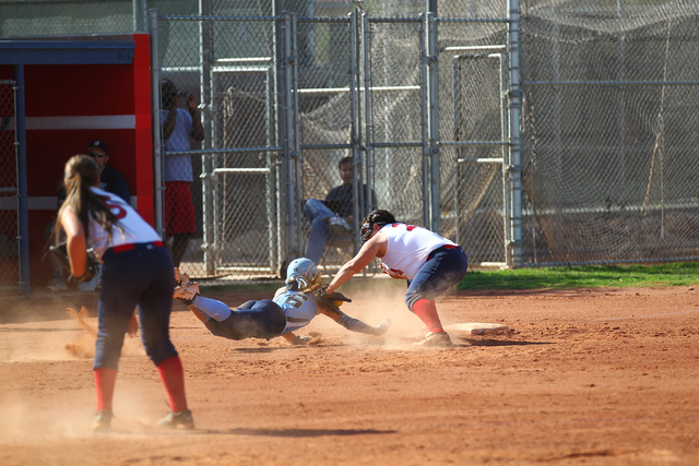 Foothill's Jordan Corn (16) dives back for third base as Liberty's Felicia Rivera (24) applies the tag at Liberty High School in Henderson on Tuesday, April 23, 2014. Foothill won 15-2. (Chase Ste ...