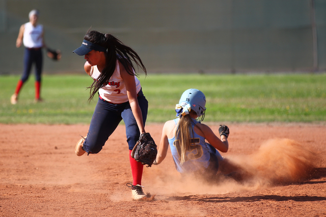 Foothill's Hannah Stevens (15) slides safely into second base past Liberty's Tiana Tapuala (2) at Liberty High School in Henderson on Tuesday, April 23, 2014. Foothill won 15-2. (Chase Stevens/Las ...