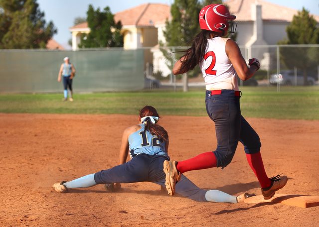 Liberty's Tiana Tapuala (2) is fourced out at first base by Foothill's Sarah Maddox (12) at Liberty High School in Henderson on Tuesday, April 23, 2014. Foothill won 15-2. (Chase Stevens/Las Vegas ...
