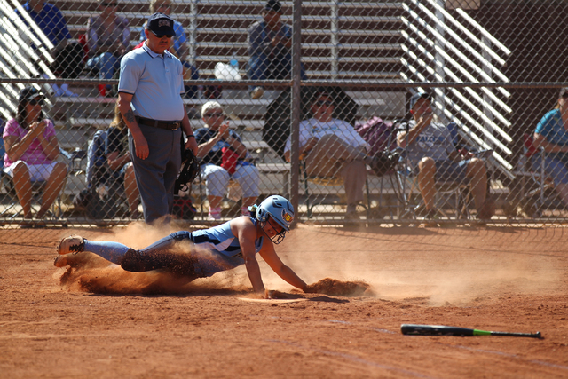 Foothill's Alexia Campbell (9) slides into home plate while playing against Liberty at Liberty High School in Henderson on Tuesday, April 23, 2014. Foothill won 15-2. (Chase Stevens/Las Vegas Revi ...
