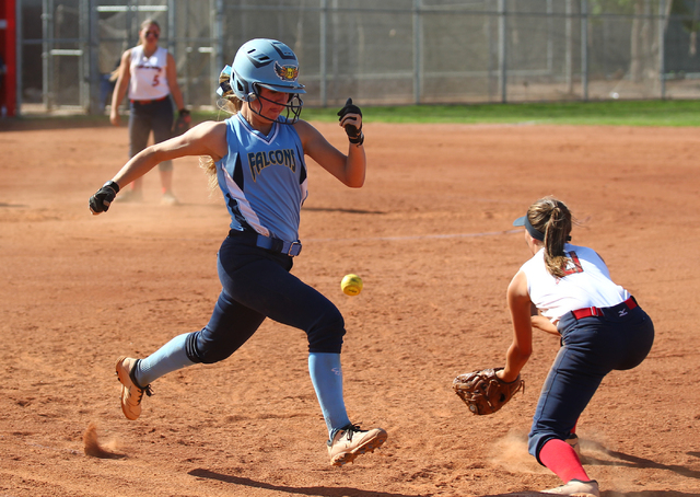 Foothill's Hannah Stevens legs out a single ahead of the throw to Liberty first baseman Kylie Hefley on Wednesday at Liberty. (Chase Stevens/Las Vegas Review-Journal)