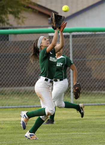Green Valley's Maggie Manwarren (2) makes a running catch against Silverado on Friday. Junior Adelia Sigala is seen in the background. (Jason Bean/Las Vegas Review-Journal)