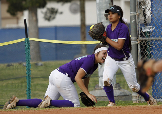 Silverado's Arieana Monturio (2) makes a catch in foul territory to record an out as teammate Heaven Calhoun (24) reacts. The Skyhawks beat Green Valley, 4-2. (Jason Bean/Las Vegas Review-Journal)