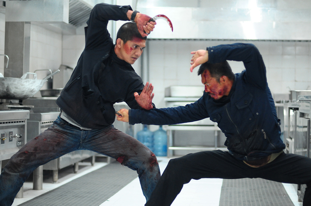 "Iko Uwais, left, as Rama and Cecep Arif Rahman as The Assassin star in ""The Raid 2."" (Akhirwan Nurhaidir and Gumilar Triyoga/Sony Pictures Classics)"