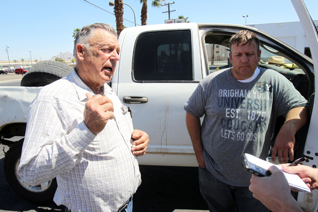 Embattled Bunkerville rancher Cliven Bundy, left, and his son Dave Bundy talk to a reporter on the corner of North Las Vegas Boulevard and East Stewart Avenue in downtown Las Vegas on Monday, Apri ...