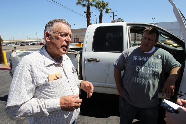 Embattled Bunkerville rancher Cliven Bundy, left, and his son Dave Bundy talk to a reporter on the corner of North Las Vegas Boulevard and East Stewart Avenue in downtown Las Vegas Monday, April 7 ...