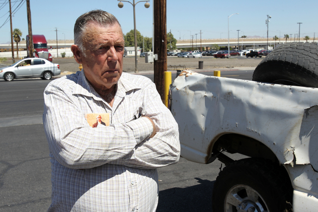 Embattled Bunkerville rancher Cliven Bundy talks to a reporter on the corner of North Las Vegas Boulevard and East Stewart Avenue after picking up his son Dave Bundy who was released from federal  ...