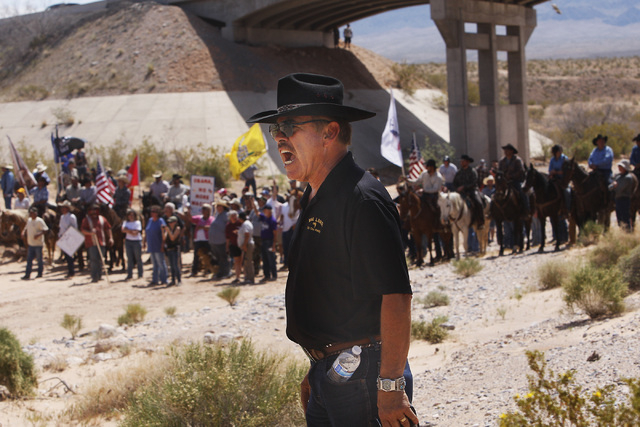 Bill Johnson yells at BLM officers as the Bundy family and their supporters gather together under the I-15 highway just outside of Bunkerville in order to confront the BLM and demand the release o ...