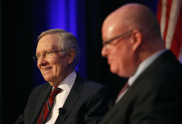 U.S. Sen. Harry Reid, D-Nev., left, takes questions Thursday, April 17, 2014 from Las Vegas Review-Journal columnist Steve Sebelius at the Hashtags & Headlines event at Paris Hotel & Casino in Las ...