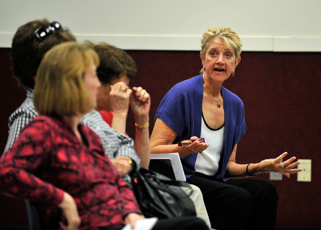 Sun City Anthem resident Michele Turner, right, asks a question during a community outreach meeting at the Whitney Ranch Recreation Center on Tuesday, April 8, 2014. The City of Henderson official ...