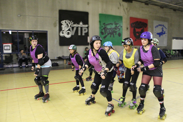 Members of Sin City Rollergirls run a drill during a practice at The Fab Lab in North Las Vegas on Nov. 25. The team will have a double header on Saturday night at the Riviera. (Brooklyn Reich/R-J ...