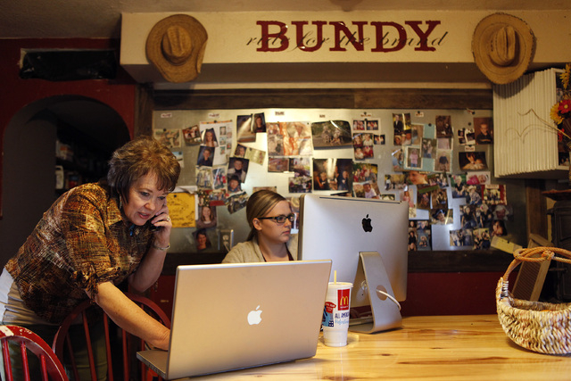 Carol Bundy, left, and her daughter Baily Logue work on computers and make calls at the Bundy ranch near Bunkerville Nev. Monday, April 7, 2014, 2014. The Bureau of Land Management has begun to ro ...