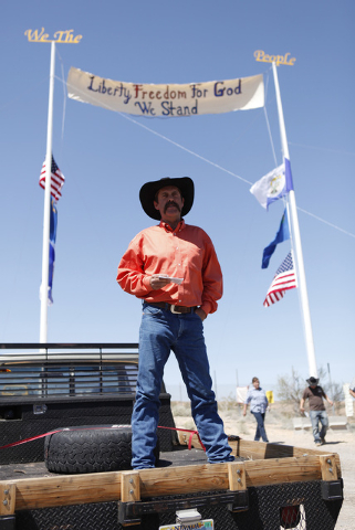 "Rancher Derrel Spencer speaks during a rally in support of Cliven Bundy near Bunkerville Nev. Monday, April 7, 2014, 2014. The Bureau of Land Management has begun to round up what they call "" ..."