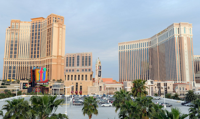 The unfinished tower is seen between The Palazzo and The Venetian, known as the St. Regis Residences condominiums, is covered with giant sheets of cloth printed with the image of a completed build ...