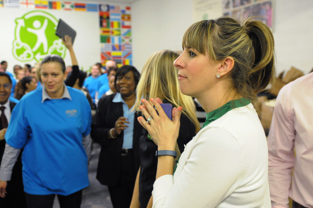 Debi Kinney, senior national sales director of North America at Clean the World, oversees volunteers during a partnership kick-off event with Las Vegas Sands Corp. at their Las Vegas facility Tues ...
