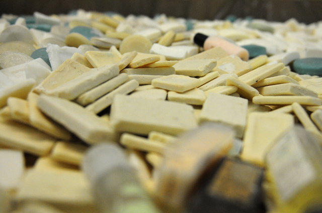Soap bars and bottles are seen inside a large container at the Clean the World facility in Las Vegas during a partnership kick-off event with the Las Vegas Sands Corp. Tuesday, April 1, 2014. Volu ...