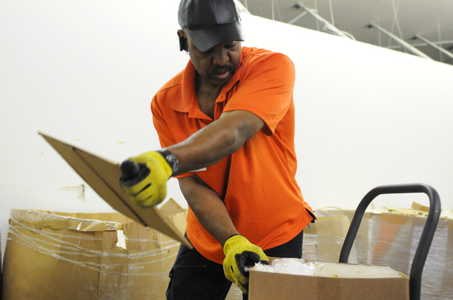 McRay Sharpe, driver at Clean the World, unloads boxes during a partnership kick-off event with the Las Vegas Sands Corp., at Clean the World's facility in Las Vegas Tuesday, April 1, 2014. Volunt ...