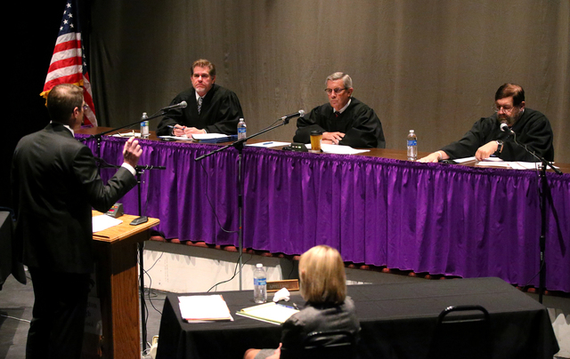 Thomas Gregory, with the Douglas County District Attorney's Office argues before Nevada Supreme Court Justices, from left, Ron Parraguirre, James Hardesty and Michael Cherry during a Supreme Court ...