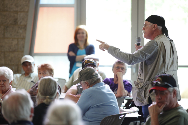 Carson Earnest asks a question during a Bridging the Budget Gap meeting presented by Henderson city officials at Heritage Park Senior Facility, 300 S. Racetrack Road, on Tuesday, April 22, 2014. T ...