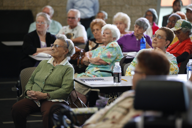 Members of the senior community listen during a Bridging the Budget Gap meeting presented by Henderson city officials at Heritage Park Senior Facility, 300 S. Racetrack Road, on Tuesday, April 22, ...