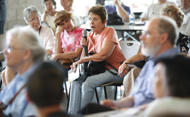 Joan Slocum asks a question during a Bridging the Budget Gap meeting presented by Henderson city officials at Heritage Park Senior Facility, 300 S. Racetrack Road, on Tuesday, April 22, 2014. The  ...