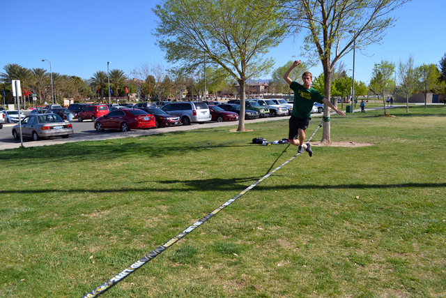 Silverado High School senior Aaron Schwarze (cq) practices slacklining at Desert Bloom Park in Henderson Saturday, March 15, 2014. Schwarze who has been slacklining for more than a year, became in ...