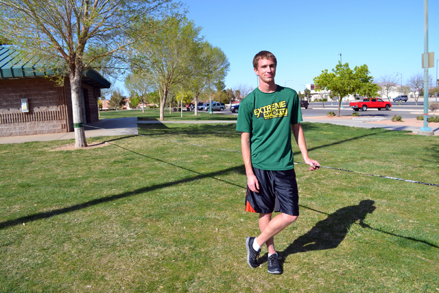 Silverado High School senior Aaron Schwarze (cq) poses for a photograph after slacklining at Desert Bloom Park in Henderson Saturday, March 15, 2014. Schwarze who has been slacklining for more tha ...