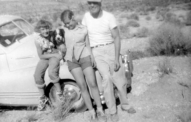 In an undated photo from the mid 1950s, Terri Robertson, left, her sister, Sophia, and their father, George Potter, sit on the front of his 1948 Pontiac during an outing in Hidden Valley, near wha ...