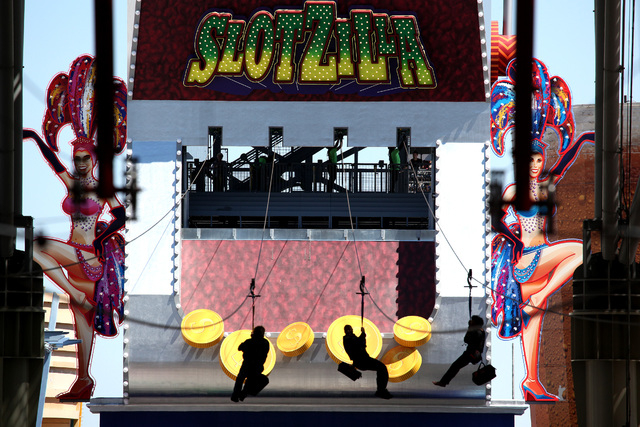 Riders fly along the zipline from Slotzilla on the second day of the attraction being open to the public above Fremont Street in Las Vegas on Monday, April 28, 2014. (Justin Yurkanin/Las Vegas Rev ...