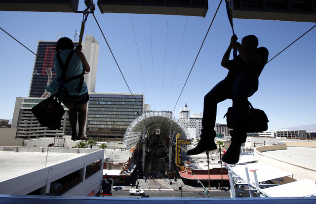 Riders shoot out of the mouth of Slotzilla on the second day of the attraction being open to the public above Fremont Street in Las Vegas on Monday, April 28, 2014. (Justin Yurkanin/Las Vegas Revi ...