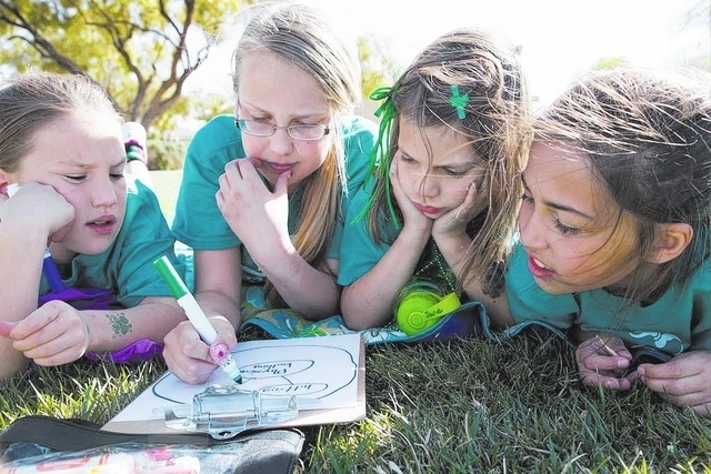 From left, Staton Elementary School stuents Afton Feller, Emma Marrufo, Jane Castillo and Daytona DeLeon work on an exercise March 17 to identify bullying at Tree Top Park, 600 Sageberry Drive, as ...