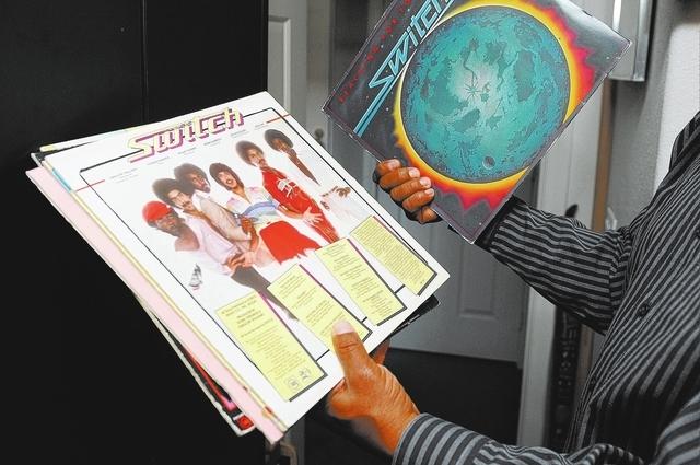 Eddie Fluellen displays some of his band's albums, March 21. (Erik Verduzco/View)