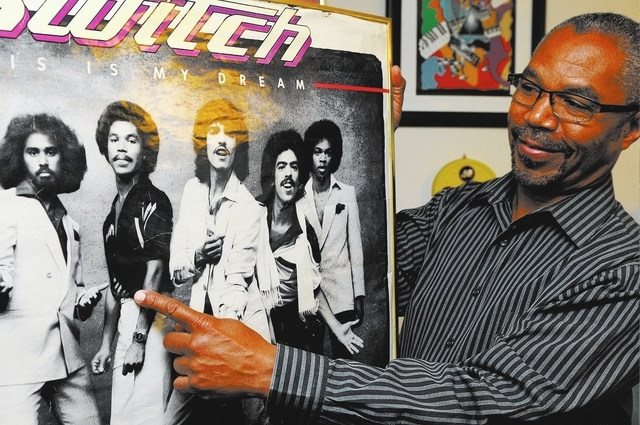"Eddie Fluellen, a member of 1970s band Switch, points to his photo in a promotional poster for his 1980s album ""This Is My Dream"" at his northwest home, March 21. Fluellen, a gold record musician, ..."