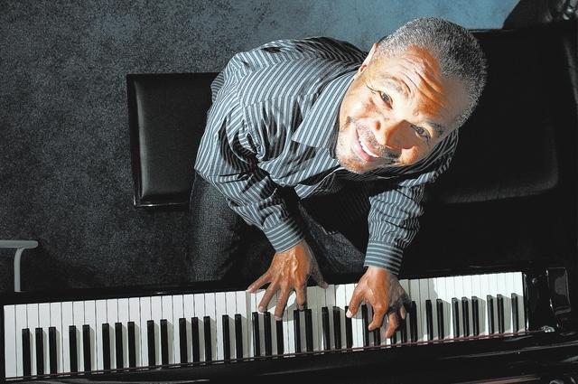 Eddie Fluellen plays a keyboard in his northwest home, March 21. (Erik Verduzco/View)