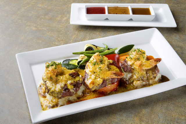 The Three Petite Filet Mignon Trio with Shrimp Scampi in three different sauces is displayed at Bernardճ Bistro located at 2021 W. Sunset Road in Henderson on Wednesday, April 9, 2014. (Jefe ...