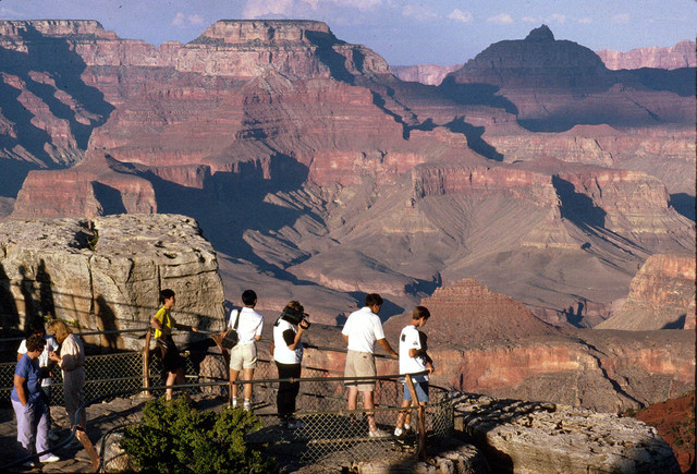 Visitors view the Grand Canyon from Mather Point on the South Rim at Grand Canyon National Park in this undated photo. (Courtesy, ace-clipart.com)