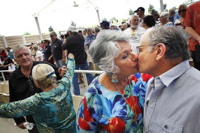 "Donna and Sheridan Dickey, from Sun city Anthem in Henderson, take part in a ""kiss off"" during the Spirit of 45 kick off event at the Henderson Pavilion on April 16, 2014. The event is meant to pa ..."