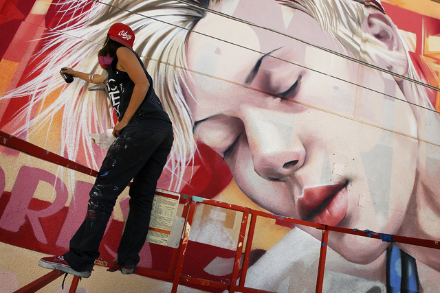 Street artist Christina Angelina, from Venice, Calif., paints a mural on the west side of the now closed Western Hotel and Casino in downtown Las Vegas on April 16, 2014. (Jason Bean/Las Vegas Rev ...