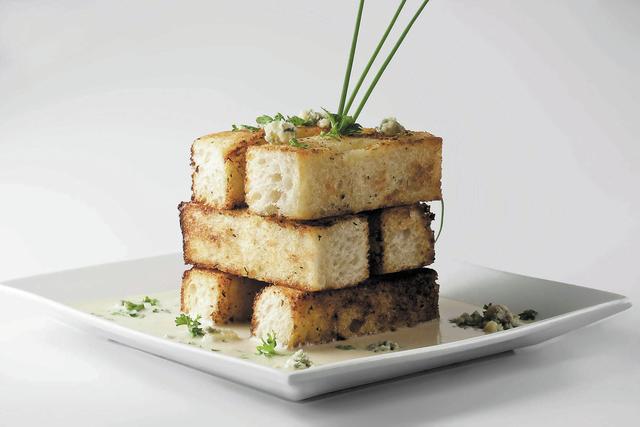 Garlic bread with Gorgonzola fondue at Strip House, Planet Hollywood Resort: A Jenga-like stack of garlic-bread sticks is accompanied by the gooey fondue. (Courtesy)